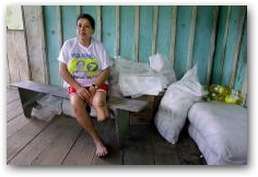Modesta Briones in her house near Parahuaco oil well #2. Doctors amputated her lower leg because of a cancerous tumor.  -> Click to enlarge