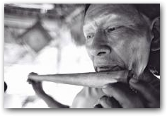 Secoya man playing traditional flute, San Pablo village  -> Click to enlarge