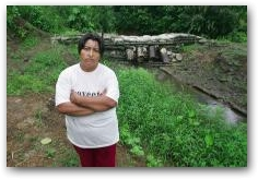 Rosa Matango who suffers from skin irritation, rashes and open sores at her polluted farm down stream from the Sacha Central separation station  -> Click to enlarge