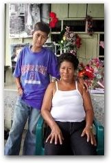 Dolores Morales sits with her fifteen-year-old son Jose who suffers from leukemia at their home in Sacha Central  -> Click to enlarge